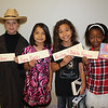 "3rd Grade Wax Museum at Annette Perry : 3rd graders from Annette Perry Elementary dressed up as their favorite famous person and posed as ""wax statues"" in the library on February 17. Visitors could push a magic button on the hand of each statue to learn about the life and accomplishments of icons such as Albert Einstein, Betsy Ross and even Tiger Woods!"