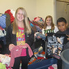 Mary Lillard Intermediate K-Kids : Mary Lillard Intermediate K-Kids, a service organization, is sponsored by the Mansfield Afternoon Kiwanis.  The students volunteered one Saturday morning at the Wesley Mission Center before Christmas.  The kids donated personal hygiene items made cards to go in the food sacks that they assembled, and helped organize items in the Mission Center store.  20 kids participated!