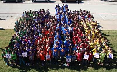 """We have included Character Traits lessons as part of Anderson for the past three years.  Last week was recognized as """"National Character Counts Week', and we are submitting an application this year to try to win an award for the school.  The more press coverage we have, the better.   Each grade level wore a color to represent the six pillars of character.  We took a school-wide picture on Friday to show we are unified pillars of character at CAE.   Red = caring Orange – fairness Yellow – respect Green – responsibility Purple – citizenship Blue – trustworthiness  This was an awesome day.  We caught over 560 acts of character during the week and everyone did a great job at picture time.  The team with the most Character Tickets had music at lunch and a """"dance"""" provided by Mr. Williams, our custodian."""